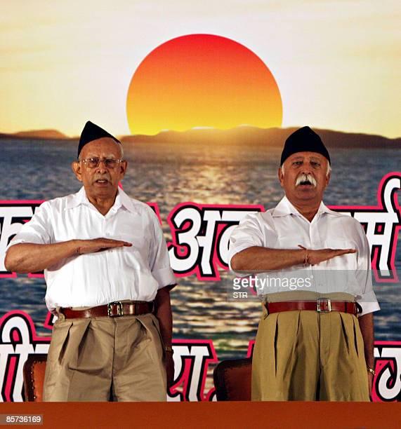 Rashtriya Swayamsevak Sangh new party chief Mohan Bhagwat and his predecessor KS Sudarshan gesture during a party gathering in New Delhi on March 31...