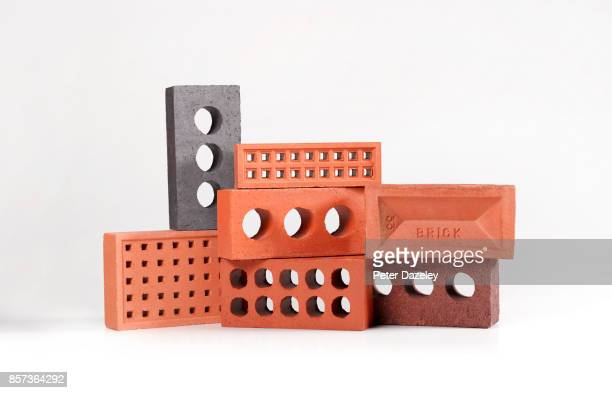 construction industry bricks on white - mattone foto e immagini stock