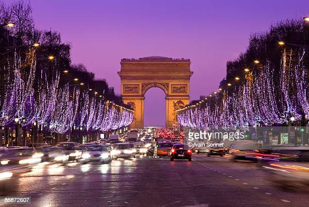 paris, champs-elysees illuminated at chris - avenue des champs elysees stock pictures, royalty-free photos & images