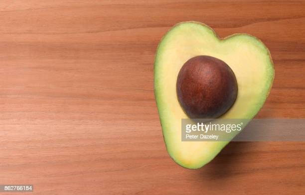 heart shaped avocado, healthy eating - avocado stock pictures, royalty-free photos & images