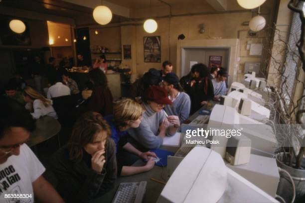 VIRTUAL' SURFERS AT THE CYBERIA CAFÉ IN LONDON