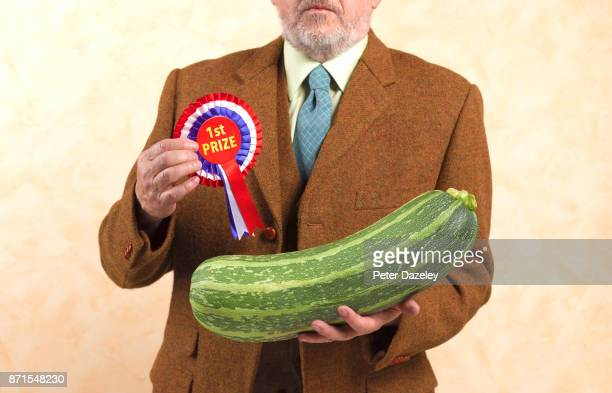 gardener with 1st prize winning marrow - award stock pictures, royalty-free photos & images
