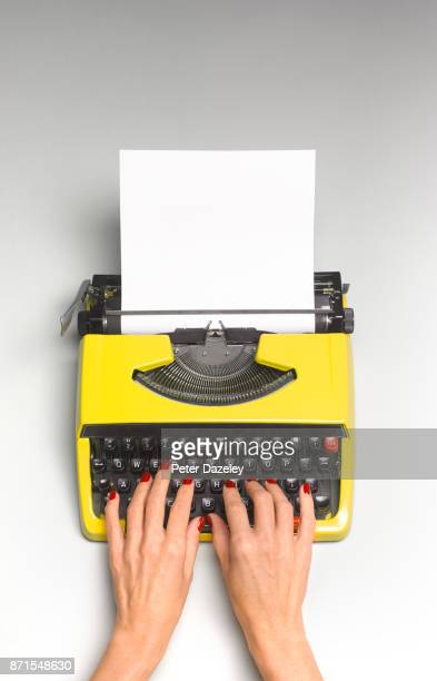 HANDS ON TYPEWRITER WITH COPY SPACE