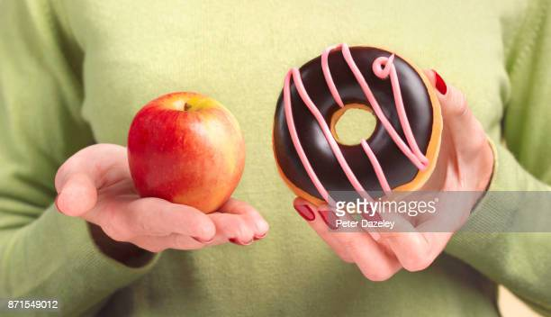 good food bad food - unhealthy living stock pictures, royalty-free photos & images