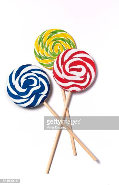 candy lollipops on sticks - lollipop stock pictures, royalty-free photos & images