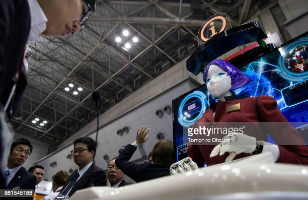 The Arisa humanoid robot receptionist is demonstrated during the International Robot Exhibition 2017 at the Tokyo Big Sight on November 29 2017 in...