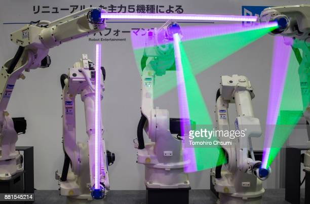 Robotic arms are demonstrated during the International Robot Exhibition 2017 at the Tokyo Big Sight on November 29 2017 in Tokyo Japan The IREX...