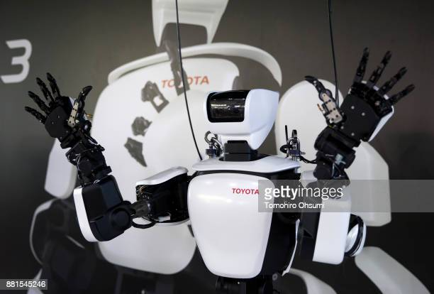 Toyota Motor Corp's THR3 humanoid robot is demonstrated during the International Robot Exhibition 2017 at the Tokyo Big Sight on November 29 2017 in...
