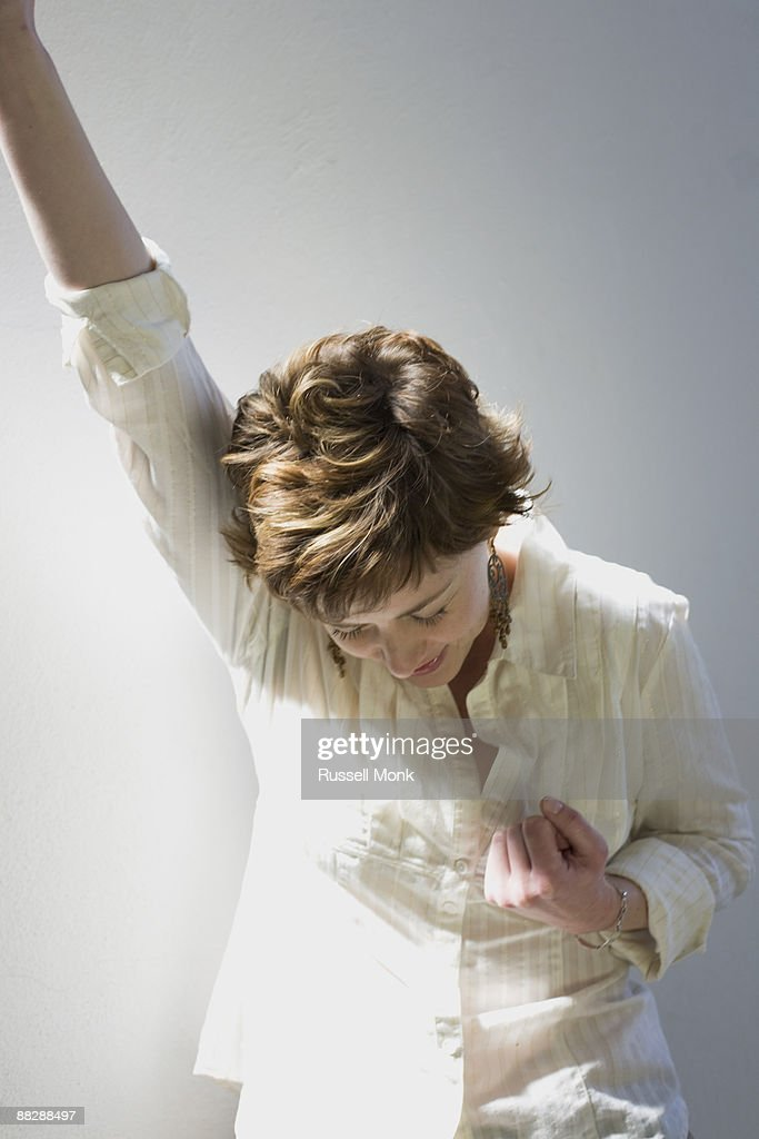 YOUNG WOMAN PUMPING HER FIST : Stock Photo