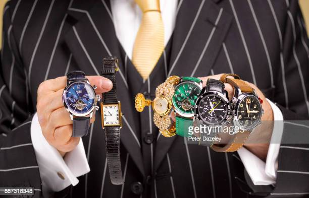 black market trader selling stolen watches - 集める ストックフォトと画像