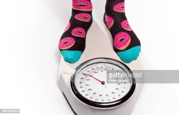 overweight unhealthy eating doughnut socks - fat people eating donuts stock pictures, royalty-free photos & images