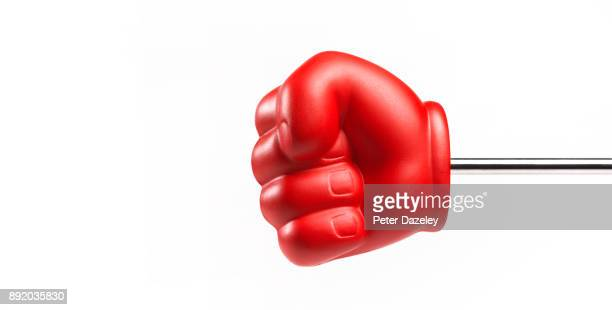 boxing glove on a stick on black - boxing gloves stock pictures, royalty-free photos & images