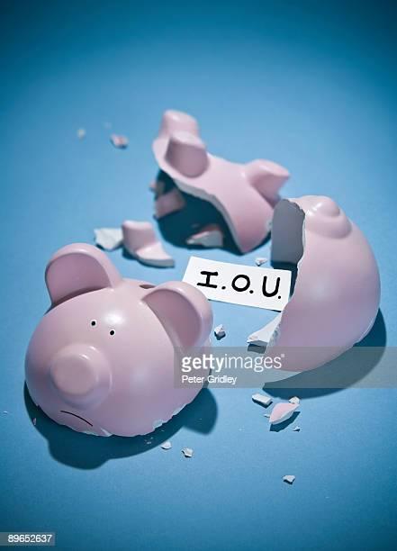 BROKEN PIGGY BANK WITH ONE I.O.U. NOTE INSIDE