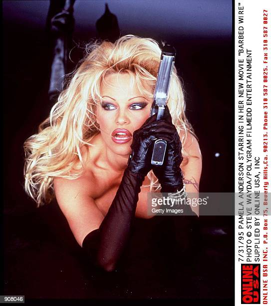 7/31/95 PAMELA ANDERSON STARRING IN HER NEW MOVIE 'BARBED WIRE'