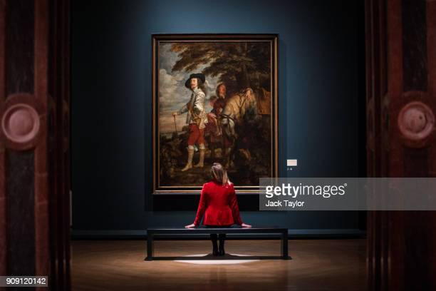 An employee poses in front of 'Charles I in the Hunting Field' by Anthony van Dyck during a press preview at the Royal Academy of Arts on January 23...