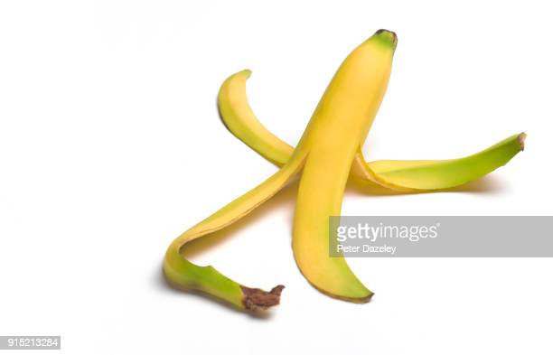 peeled banana with copy space - 果物の皮 ストックフォトと画像