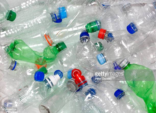 water bottles in recycling bin with recyclable caps - プラスチック汚染 ストックフォトと画像
