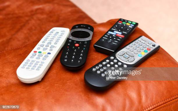 remote controls on couch - remote control stock pictures, royalty-free photos & images