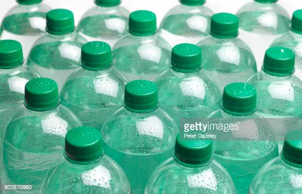 refreshing ice cold sparkling bottled water - carbonated water stock pictures, royalty-free photos & images
