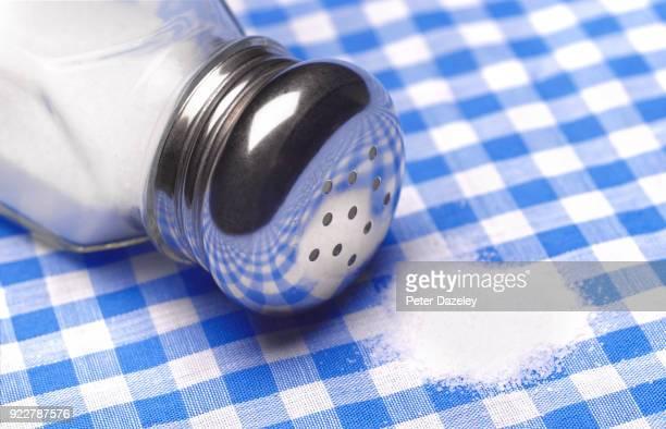 spilt salt from a salt shaker - salt mineral stock pictures, royalty-free photos & images