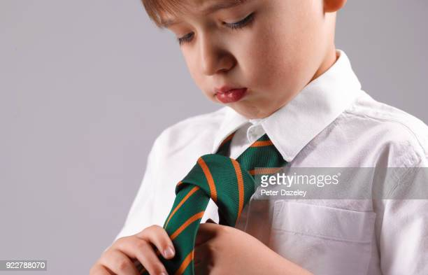 SIX YEAR OLD BOY LEARNING TO DRESS HIMSELF