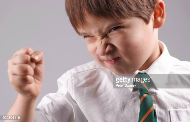 angry schoolboy lashing out - anger stock pictures, royalty-free photos & images
