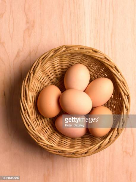newly laid organic hens eggs - basket stock pictures, royalty-free photos & images