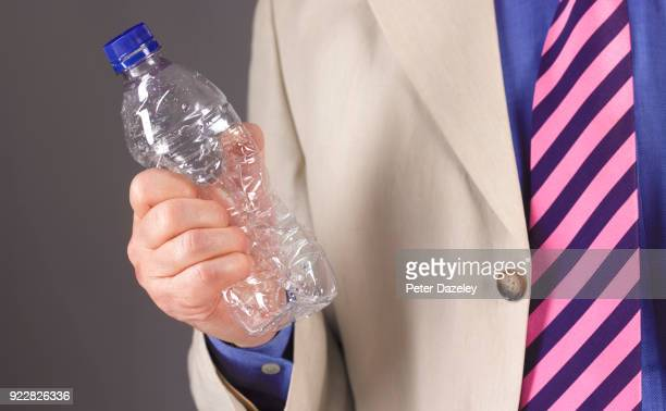 MAN WITH EMPTY BOTTLE FOR RECYCLING