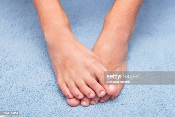 close-up and macro details 775109177 - male feet on face stock photos and pictures