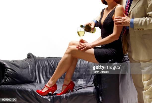 MAN GETTING GIRL DRUNK