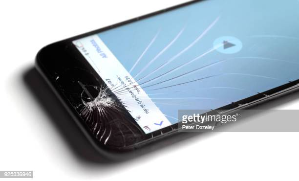 cracked mobile smart phone screen - breaking stock pictures, royalty-free photos & images