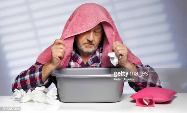 man flu, inhaling steam from a bowl - cold virus stock pictures, royalty-free photos & images