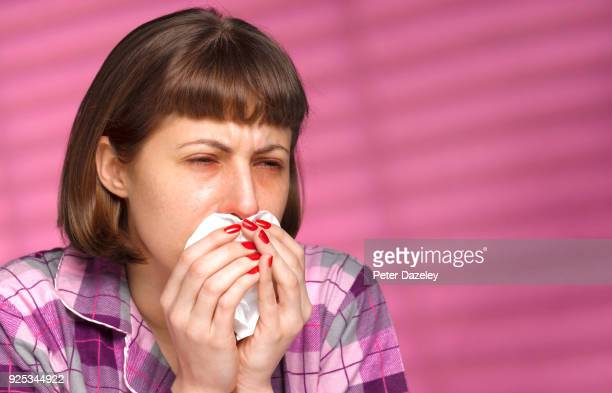 woman with cold/flu blowing her nose close up - coughing stock pictures, royalty-free photos & images