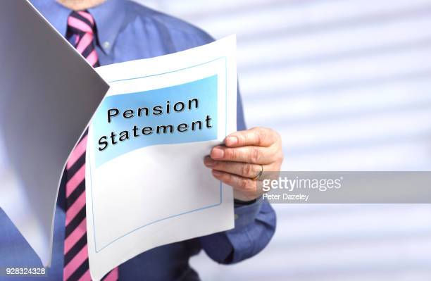 businessman reading pension statement - retirement stock pictures, royalty-free photos & images