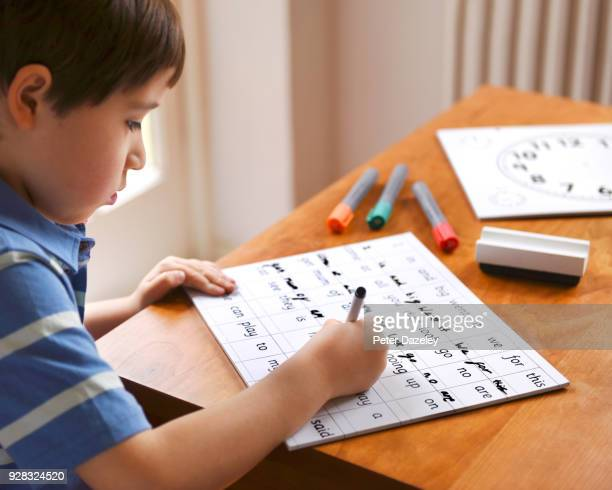 boy learning to write - spelling stock pictures, royalty-free photos & images