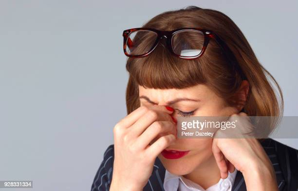 businesswoman with headache after being fired/let go/given the sack - tired stock pictures, royalty-free photos & images