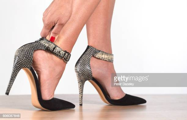 painful high heels - high heels stock pictures, royalty-free photos & images