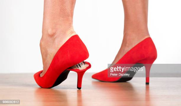 snapped heel on red stilettos - human foot stock pictures, royalty-free photos & images