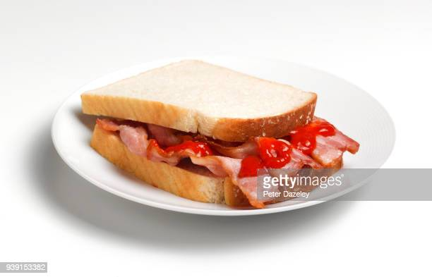 bacon sandwich with ketchup, close up - tomato sauce stock pictures, royalty-free photos & images