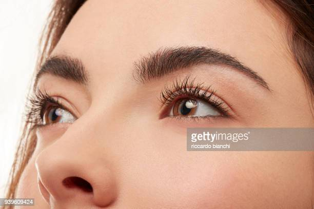 EYES DETAIL OF A BRUNETTE WOMAN WITH NATURAL LOOK