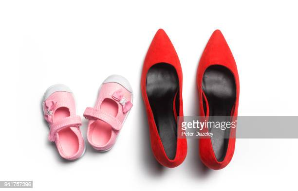 baby girl and adult woman's shoes - dress shoe stock pictures, royalty-free photos & images