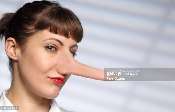 untrustworthy woman with long nose - long nose stock photos and pictures