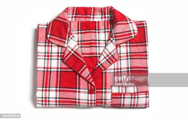 woman's pyjamas ready for bedtime - tartan stock pictures, royalty-free photos & images