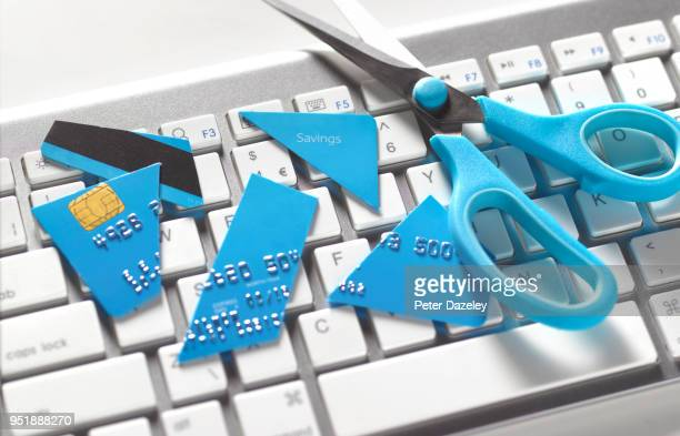 cutting up credit card online shopping - cutting stock pictures, royalty-free photos & images