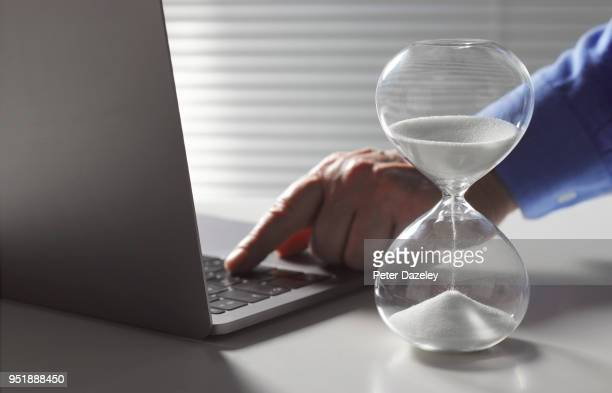 working late businessman using laptop - countdown stock pictures, royalty-free photos & images