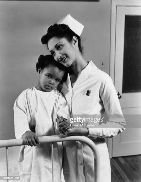 NURSE HOLDING GIRL IN HOSPITAL