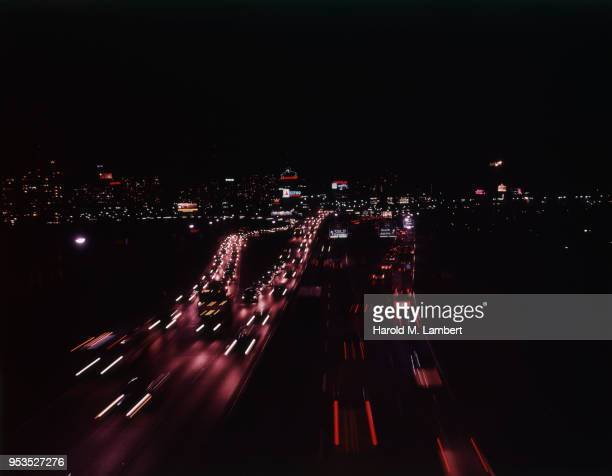 USA, PENNSYLVANIA, PHILADELPHIA, CROWDED STREET IN CITY AT NIGHT