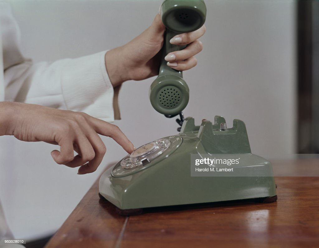 WOMEN USING ROTARY DIAL TELEPHONE : Stock Photo