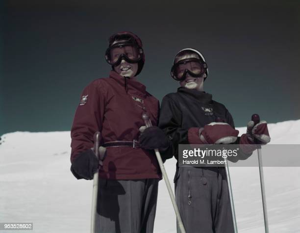 COUPLE SKIING IN SNOW