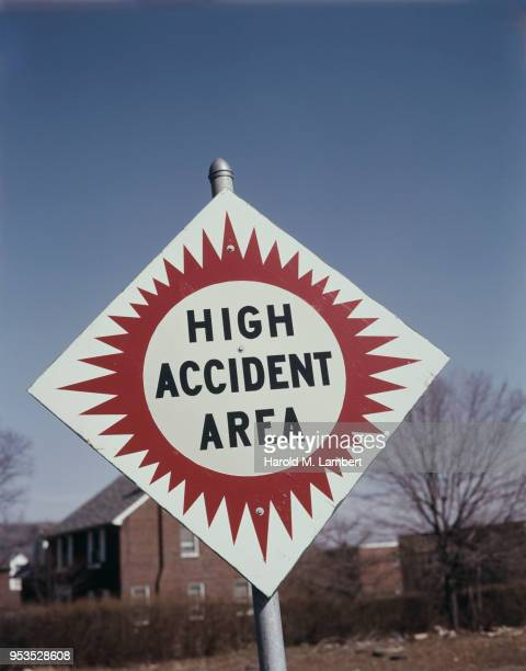 CLOSE-UP OF HIGH ACCIDENT AREA SIGN